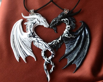Two Tattooed dragons pendants black and white dragons pair