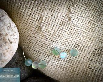 Iridescent green drop earrings