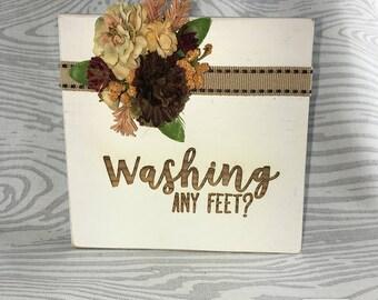 Photo Block 'Washing Any Feet?'