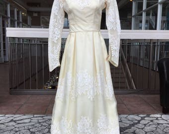 Long Sleeved Wedding Dress with Sheer Sleeves and Wide Belt
