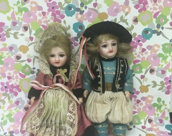 A Late 19 Century Pair of Bisquit Dolls