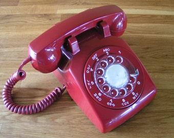 Classic Red Vintage Rotary Dial Telephone made in Canada by Northern Telecom in the 1970's