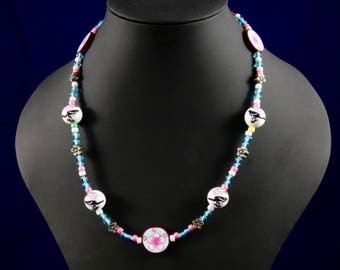 Bird and cherry blossom necklace.