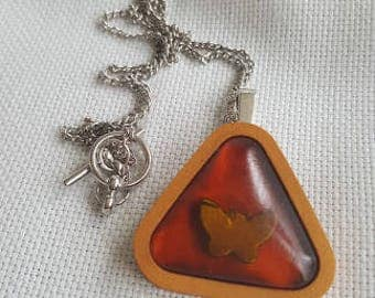 Resine and polymer clay pendant.