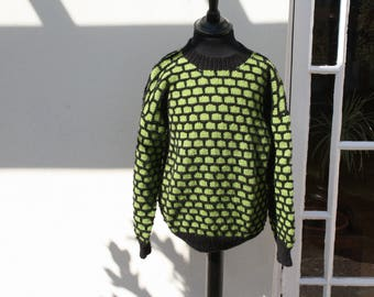 """Hand knitted with love by me. A childs """"brick """" pullover in lime & black"""