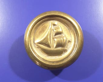 Early 1900's pressed brass button of a boat.