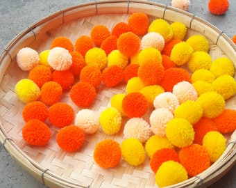 50 Piece orange pompoms,yellow pom poms,peach pompoms.