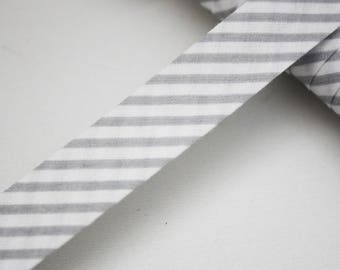 Bias striped gray and white stripes 18 mm, folded, gray and white