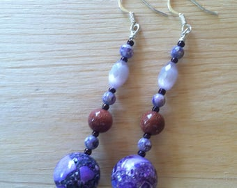 Long purple beaded dangles with copper accents