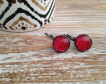 Dangle red earrings.