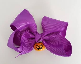 Purple Bow with Jack-o'-Lantern Bell