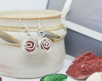 Silver wire wrapped dangle earrings with glass beads