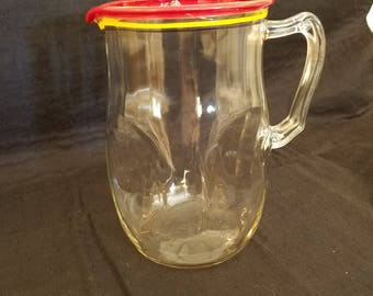 "Vintage Pitcher 8 1/2"" tall with red, yellow and black bands"