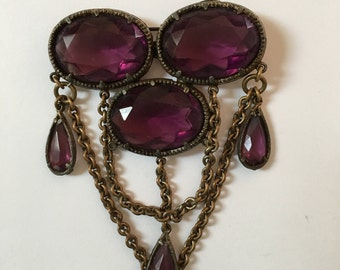 Vintage brooch with purple glass stones