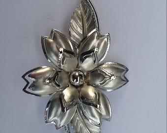 Silver colored flower brooch