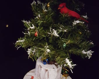 Cardinal in the Christmas tree.