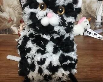Fat black and white pompom kitty