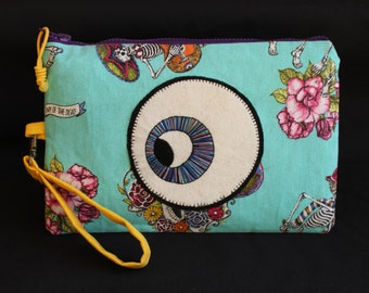 Hand-made Clutch and handmade fabric Mexican motifs.