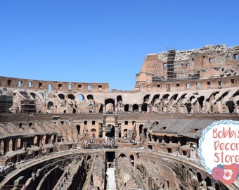 Inside the Colosseum in Rome, Italy on a bright summer day