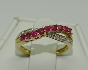 14K Yellow gold Ruby and Diamond Ring. Ruby 0.27ct. Diamond 0.02ct.