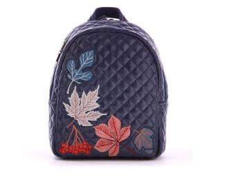 Blue backpack with leaves