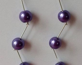 Purple pearls on zig zag