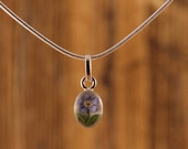 Sterling Silver Miniature Pressed Forgetmenot Flower Oval Pendant