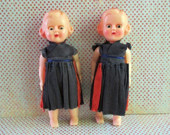Pair of Vintage Plastic Jointed Dolls - Open and Closed Eyes - Paper Dresses