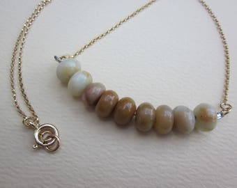 Pale umber, beige and cream amazonite array necklace on gold filled chain