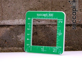 Silmuccaruutu -Knitting Gauge Checker, green / white knitting tool with two scales, precise square made out of recycled plastic