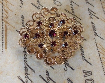 Stunning signed vintage 12k gold filled filigree flower brooch with red ruby's