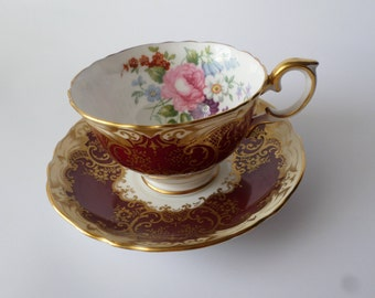 Crown Staffordshire tea cup and saucer, burgundy red, gold , floral rose signed J.T. Jones