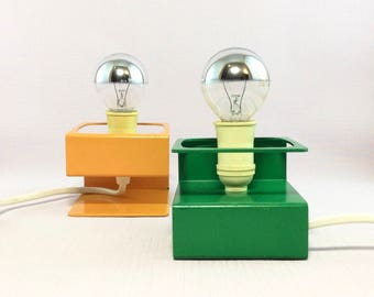 Schmahl + Schulz set of two small space age modernist S-shaped table lamps, desk lamps, bedside lights in yellow and green folded steel.