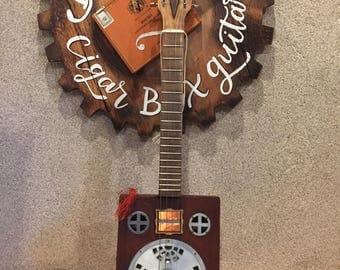 RUST BELT CBG'S  LaGloria Cubana Cigarbox Guitar