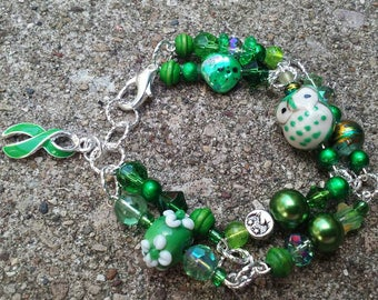 Green Awareness Ribbon Double Strand Bracelet Bipolar Disorder Cerebral Palsy Glaucoma Fanconi's Syndrome Kidney Disease Mental Health