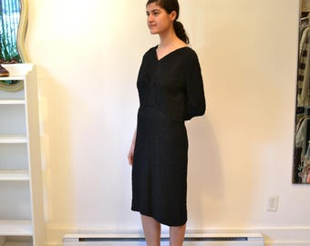 1950s Black Evening Gown. V-Neck, 3/4 Sleeves. Textured Knit Rayon Fabric. Knee Length. Paula Dean Originals