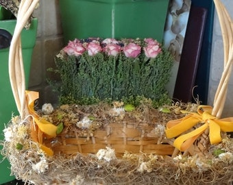 Vintage easter basket, pale weave, with yellow bows and spring flowers