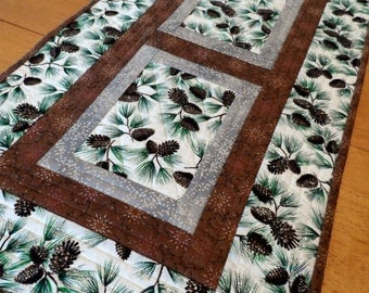 Holiday table runner, Christmas table topper, modern table quilt, quilted pine cones table mat, white, green, brown, quiltsy handmade