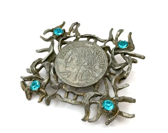Brutalist Coin & Thorn Brooch by Jeanne, Republique Francaise Coin Centerpiece, Blue Rhinestone Accents, Rare Signed Vintage Gift for Her