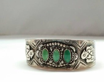 Native American sterling/turquoise cuff bracelet with thunderbird motif.