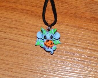Light Blue Dragon holding a Pumpkin Necklace