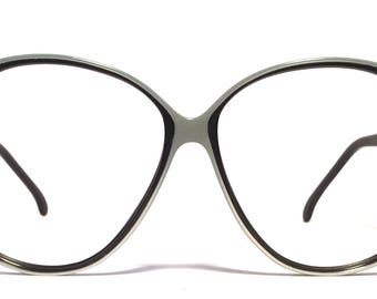 Vintage eyewear. Made in Italy. Marcolin. 1980's. Excellent quality and condition! Silver on gloss black color. Cool large size! Urban Woman