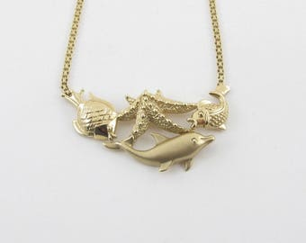 14k Yellow Gold Starfish Dolphin And Fish Nautical Necklace 16 Inches  10.7 grams
