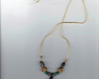 this necklace has nylon material  threaded with beautiful beads 1960's