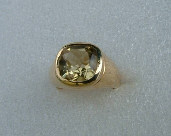 Lemon Quartz and Gold ring-Signet style ring in 9 carat yellow gold set with a cushion cut Lemon Quartz. Quartz and gold ring
