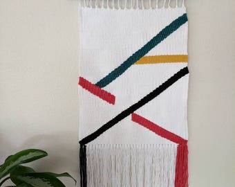 White Geometric Woven Wall Hanging | White with Red, Yellow and Turquoise Striped Weaving | Multi-Colored Striped Wall Hanging