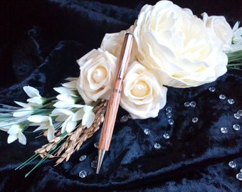 Slimline wooden pen in Red Oak. Beautiful and elegant pen perfect for both him and her. Stunning gift for any occasion.