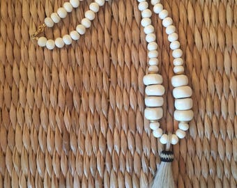 Bone beaded necklace with a horsehair tassel