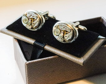 Elgin watch movement cufflink's in display box.