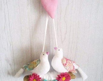 Handmade doves mobile with hand sewn flowers